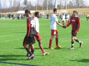 ASA Milan Black Hawks (in black/red) shake hands with Upper Freehold/Allentown Strikers after their 2-2- draw in 2013 Jefferson Cup play.