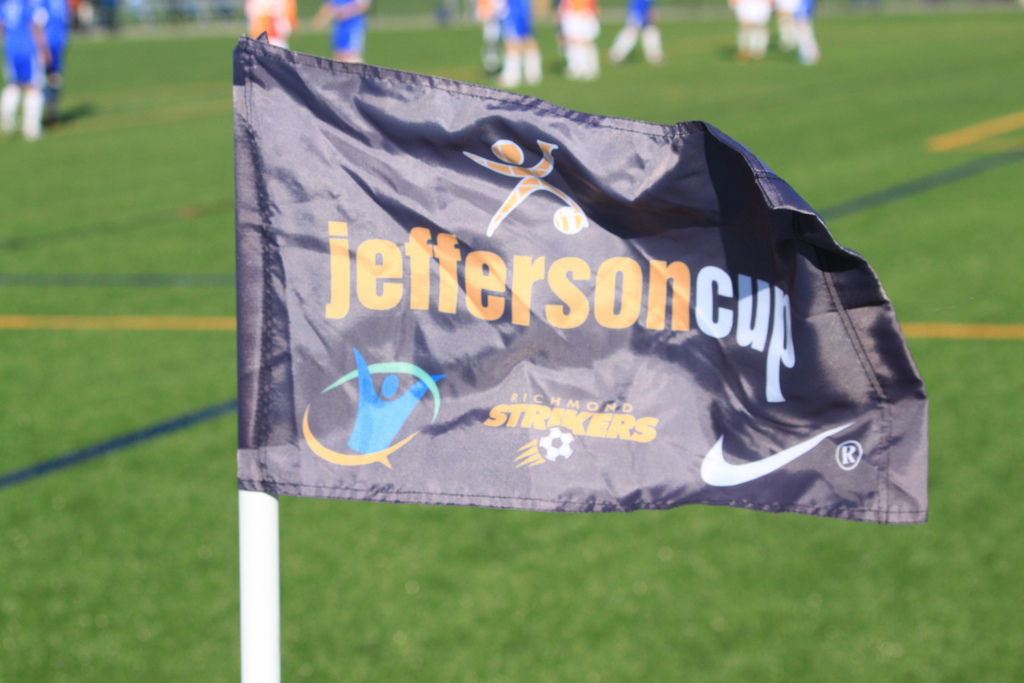 A corner flag flaps in the heavy winds on the tournament's opening day.