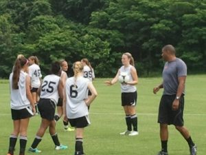 Maryland coach Jonathan Morgan works with players at the FASA Girls Collegiate Soccer Camp on June 17, 2013.